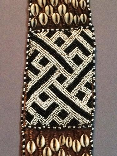 beaded belt with back and white beads and cowrie shells