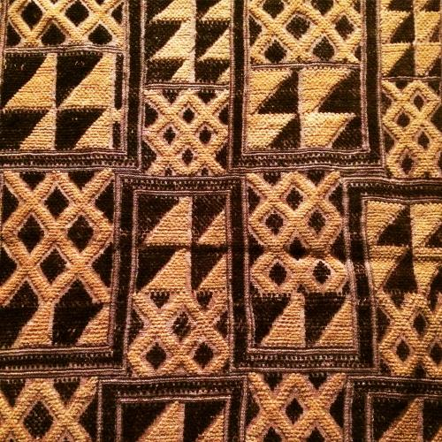 panel made of contrasting dark and light fiber with geometric motifs