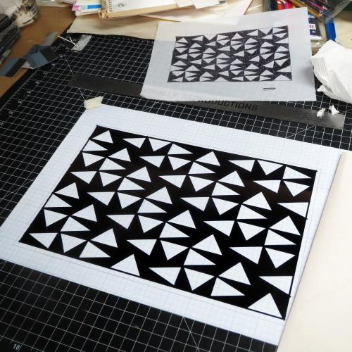 design studies with black and white triangles on the work desk, by Bill Brookover