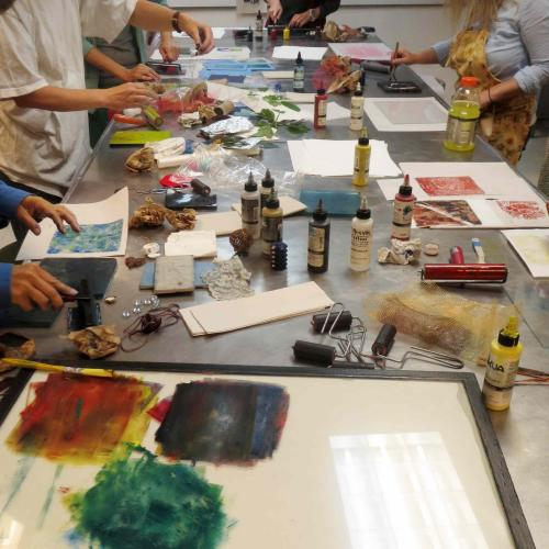 the studio work table with inks and tools shared by the class